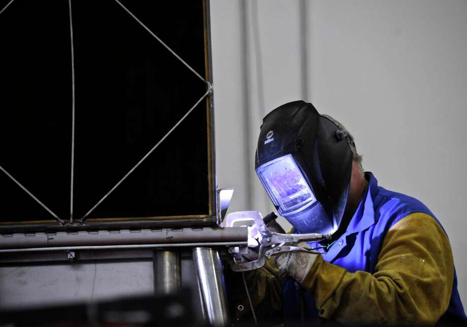 A FuelCell Energy worker welds in February 2017 at the company's Torrington, Conn. manufacturing plant. Photo: H John Voorhees III / Hearst Connecticut Media / The News-Times