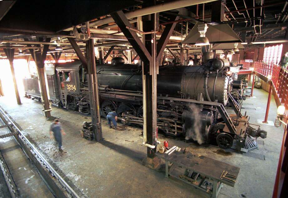 A locomotive pulls into the roundhouse at the Steamtown National Historic Site in Scranton, Pa. Photo: George Widman / Associated Press / AP