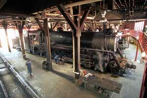 A locomotive pulls into the roundhouse at the Steamtown National Historic Site in Scranton, Pa.
