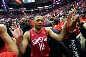 Houston Rockets guard Eric Gordon (10) is greeted by fans after the team's win over Utah Jazz in Game 5 of an NBA basketball playoff series, in Houston, Wednesday, April 24, 2019. Houston won 100-93. (AP Photo/David J. Phillip)