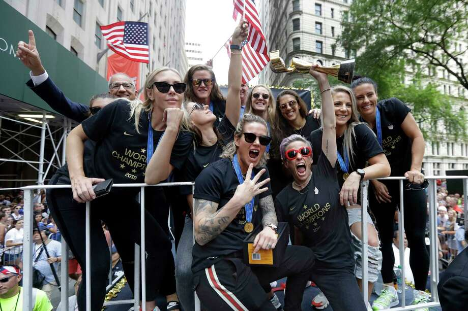 Megan Rapinoe holds the Women's World Cup trophy as the U.S. women's soccer team is celebrated with a parade along the Canyon of Heroes, Wednesday, July 10, 2019, in New York. The U.S. national team beat the Netherlands 2-0 to capture a record fourth Women's World Cup title. Wednesday, July 10, 2019. Photo: Richard Drew, AP / Copyright 2019 The Associated Press. All rights reserved.