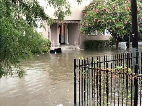 Photos show eerie scene as torrential rains flood New Orleans - SFGate
