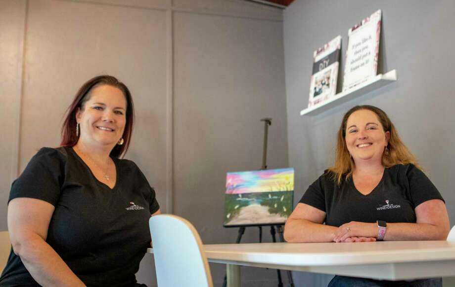 Rachel Jahn, left, and Rachel Anderson sit at a painting station at Wine & Design in Montgomery. The studio is a design and sip franchise for groups of all ages and talent ranges. Photo: Cody Bahn, Houston Chronicle / Staff Photographer / © 2018 Houston Chronicle