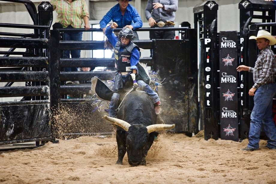 The Red, White and Bulls Miniature Bull Riding Invitation in Lockney included young riders from across the country. Photo: Don Brown/For The Herald