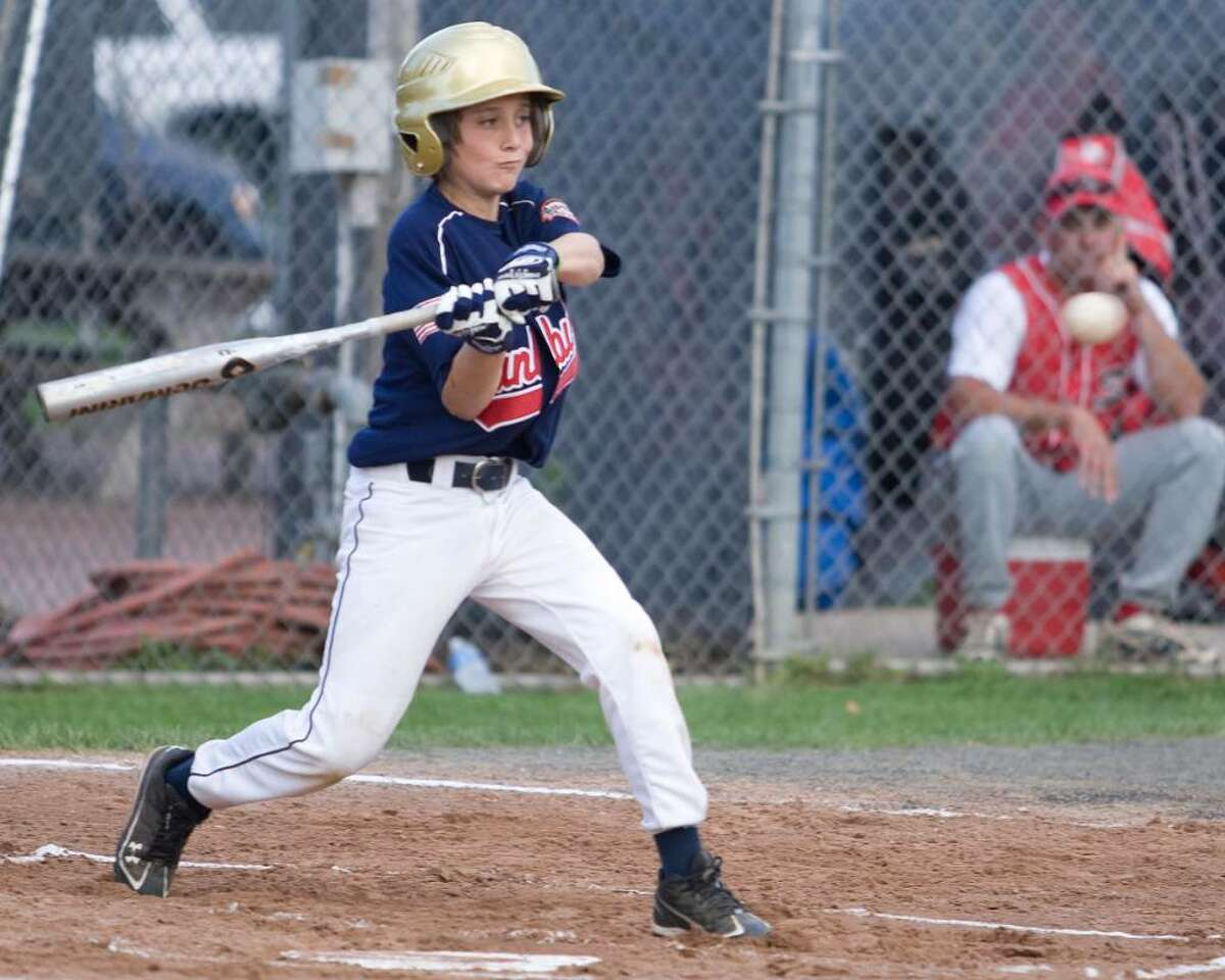 Danbury's Jared Volpe blasts a grand slam homer against Southbury Friday night at Rogers Park in the Cal Ripken 11-year-old state tournament game for the right to play New Milford the championship.