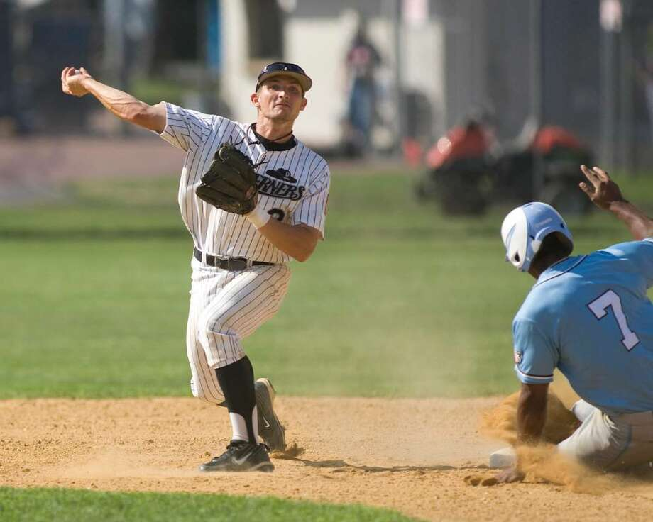 The Westerners' Tucker Nathans turns a double play against Laconia Friday at Rogers Park. Photo: Barry Horn / The News-Times Freelance