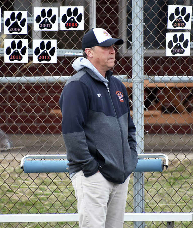 Edwardsville High School coach Dave Lipe watches from the sideline during a match against Alton in the spring.