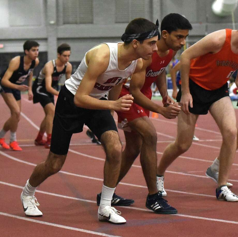 New Canaan's Alessandro Malagoli gets set to start the 1,600-meter run at the FCIAC indoor track and field championships at the Floyd Little Athletic Center in New Haven on January 31. Photo: Dave Stewart / Hearst Connecticut Media / Hearst Connecticut Media