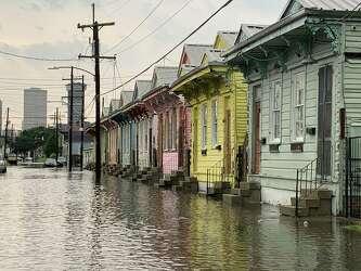 Photos show eerie scene as torrential rains flood New