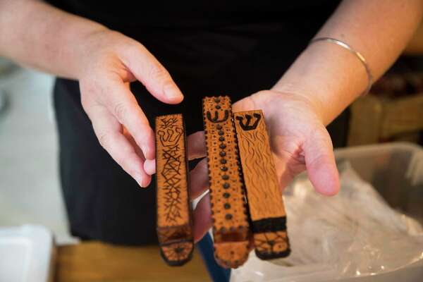 Chava Gal-Or holds mezuzahs made out of wood by her son Aryeh Grossman who is a wood artisan. Gal-Or sends them to Jewish families who lost theirs during natural disasters. Friday, June 21, 2019, in Houston.