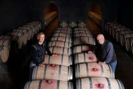 Philip Togni and his daughter Lisa stands among their family wine barrels, Tuesday March 11, 2014, at the Philip Togni Winery in St. Helena, Calif. After over 60 years of making wine Philip has settled atop Spring Mountain, outside St. Helena, where he still makes Cabernet very much in the style of the legendary 1969 Chappellet. He is believe to be one of the greatest American wines ever.