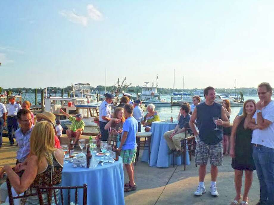 The Norwalk Seaport Association has rescheduled its rained out June 29 Docktails and Oysters event at Norm Bloom and Son oyster farm in Norwalk to July 20. Photo: Norwalk Seaport Association / Contributed Photo