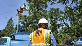 Matt Edgar an appentice lineman with PG&E helps out AJ Jensen as he does routine repairs along Hall Road, Wednesday May 29, in Santa Rosa, CA.
