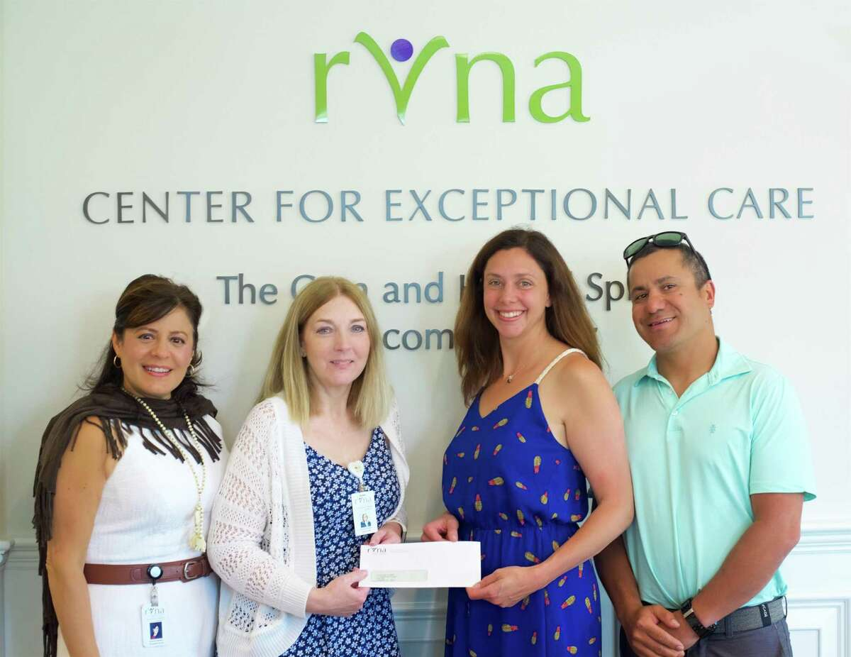 Theresa Santoro, MSN, RN, and Chris Palmer, RN, of RVNA accept the Couri Nursing Education Scholarship Gift from Megan and Chris Couri. Missing from the photo is John Apinis, RN.