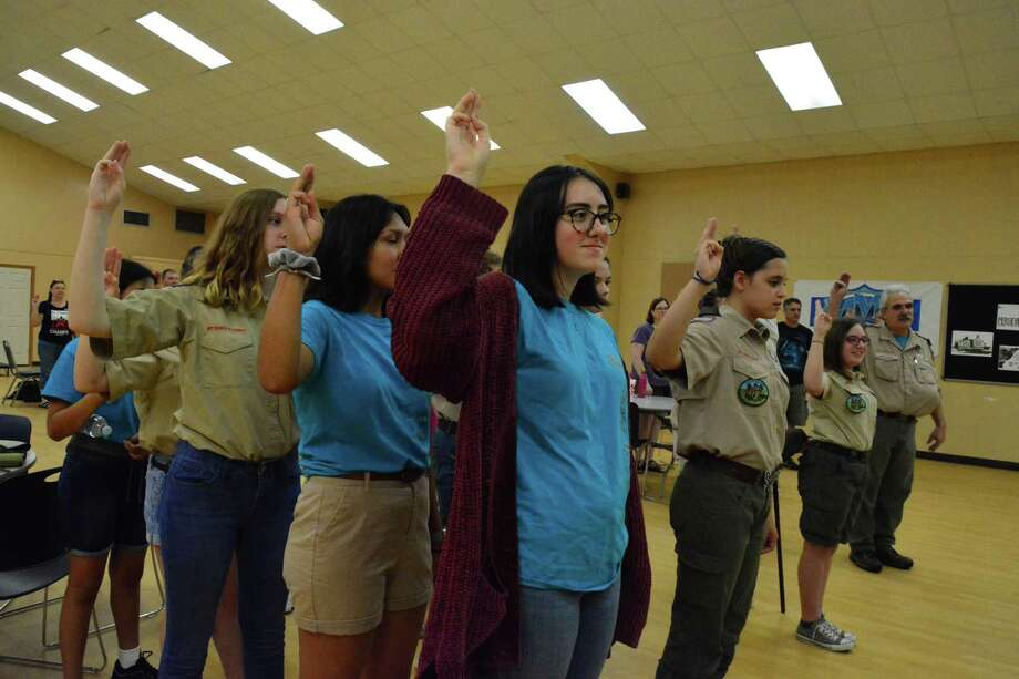 Members of Scouts BSA Troop 4640 in Pearland give the scout oath at a meeting. The group started in February after the Boy Scouts of America officially changed its name to Scouts BSA and welcomed girls as members. The troop is chartered at Pearland First United Methodist Church. Photo: Yvette Orozco / Yvette Orozco