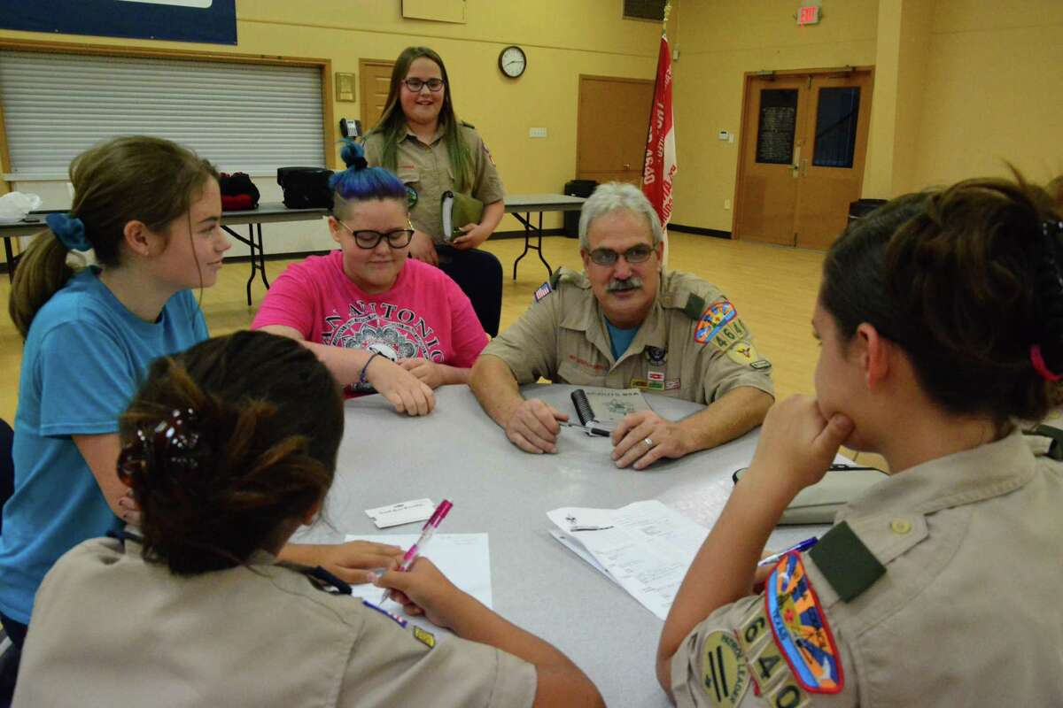 Scout Master David Albee checks in with members of Troop 4640, of which his daughter is a member.