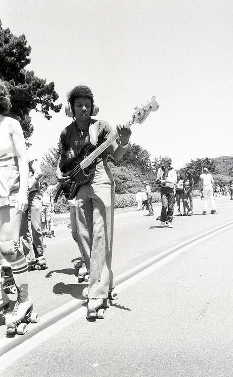 July 28, 1979: A skater with a bass guitar rolls down John F. Kennedy Drive in Golden Gate Park during the peak of roller skating in San Francisco. Photo: John Storey / The Chronicle 1979