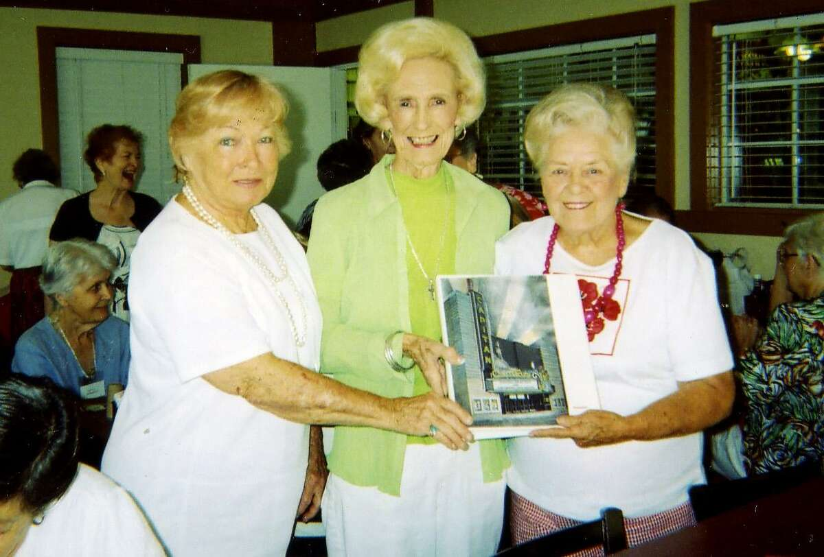 Ashley Wysong, incoming president of the Pasadena Community Club (at left) and Pat Riley, former City Council member (center) presented Nona Phillips with a book of history on the Capitan Theater. Nona Phillips is president of the Society for the Restoration of Historical Areas of Pasadena
