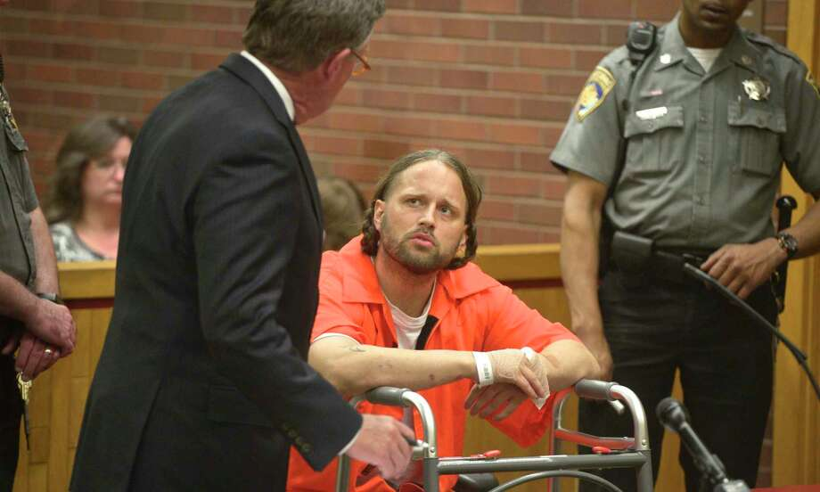 Aaron Bouffard, right, of Bristol, with John Walkley from the Public Defenders Office, was arraigned in Danbury Superior Court on Wednesday in connection to a knife-wielding incident on July 3rd. Bouffard was shot by Danbury Police officer Alex Relyea following a two-hour manhunt. July 10, 2019, in Danbury, Conn. Photo: H John Voorhees III / Hearst Connecticut Media / The News-Times
