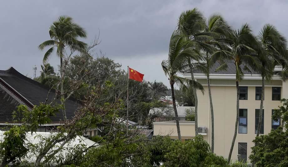 A Chinese flag flies at the Chinese Embassy in Nuku'alofa, Tonga. Beijing is pouring billions of dollars in aid and loans into the kingdom of 106,000 people, equivalent to 25 percent of its GDP. Photo: Mark Baker / Associated Press