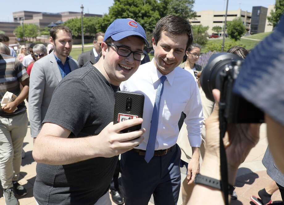 Democratic presidential candidate Pete Buttigieg poses for a selfie at a pride festival last month in Des Moines, Iowa. Photo: Charlie Neibergall / Associated Press