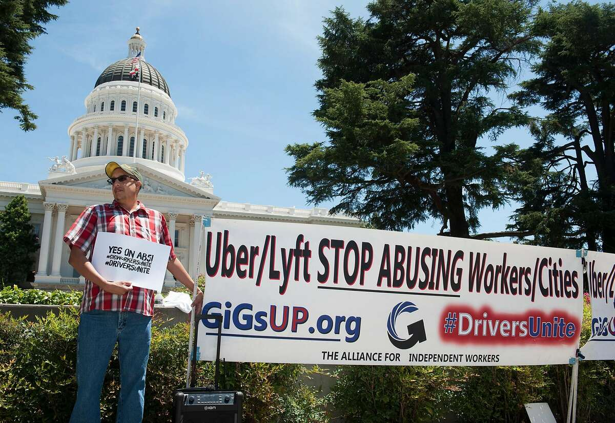 Carlos Pati�o of Sacramento has supplemented his income from his county government job by driving for Uber the last three years. He used to earn 80 percent of a ride and now it has dropped to 50 percent. He doesn't like this and is in favor of AB5. Drivers from Lyft and Uber rally against AB5, a bill that would turn drivers into employees on the west steps of the Capitol on Tuesday, July 9, 2019.
