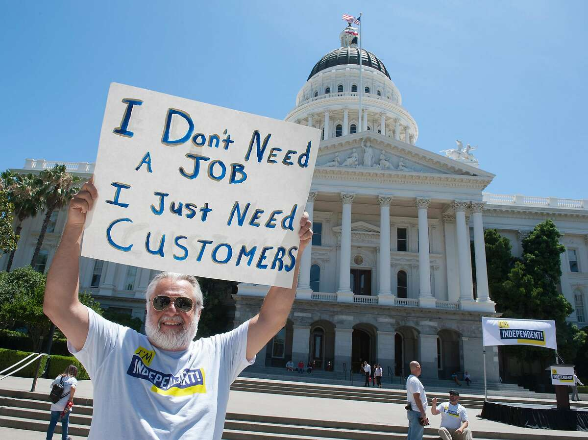 David Frazier, 62, of Sonoma, has been driving for Uber for three years. He doesn't want a job, just customers. Drivers from Lyft and Uber rally against AB5, a bill that would turn drivers into employees on the west steps of the Capitol on Tuesday, July 9, 2019.