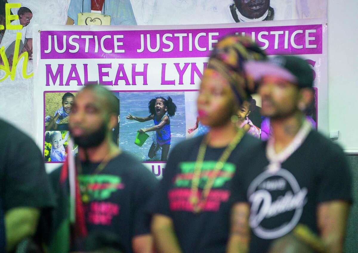 """A banner calling for Justice for Maleah hangs on the wall during a gathering of community activists speaking out against violence against children, at the SHAPE Community Center in Houston, Tuesday, July 9, 2019. The group called for a """"Cease Fire"""" in the wake of many recent deaths of children."""