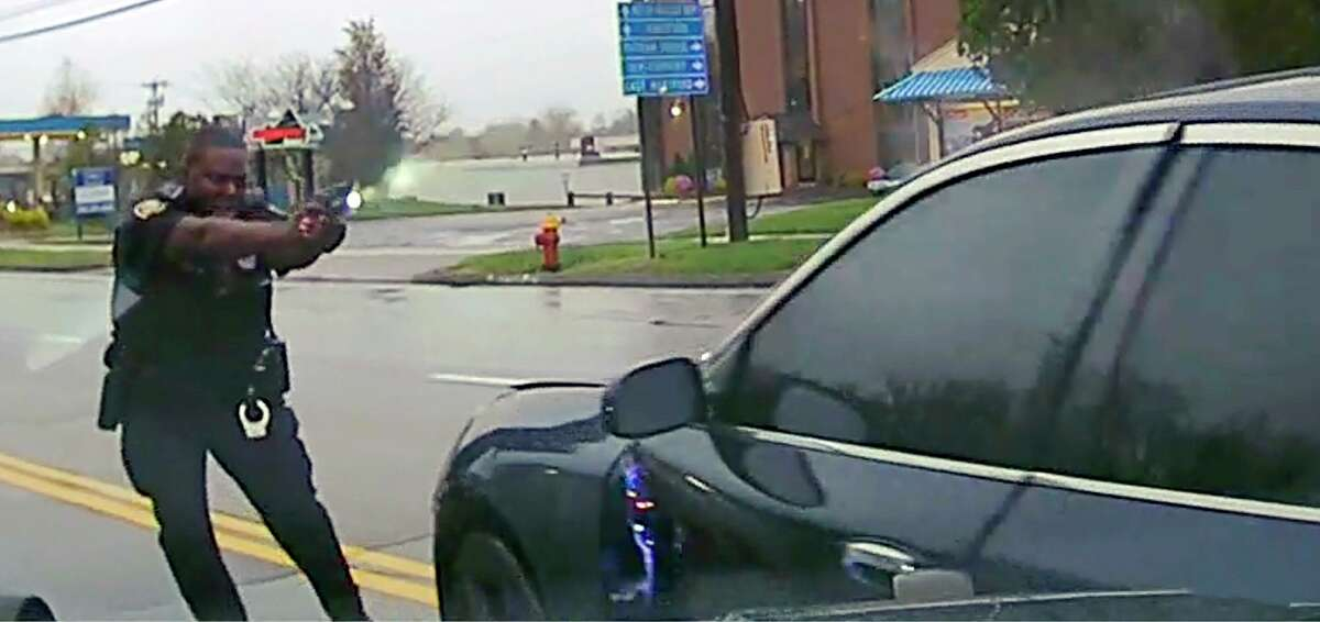 This still image from police dash camera video released Friday, May 3, 2019, by the Hartford State's Attorney shows Police Officer Layau Eulizier pointing his weapon at a car being driven at him by Anthony Jose Vega Cruz during an attempted traffic stop April 20 in Wethersfield, Conn. Eulizier shot through the windshield, striking Vega Cruz, of Wethersfield, who died two days later at a hospital.