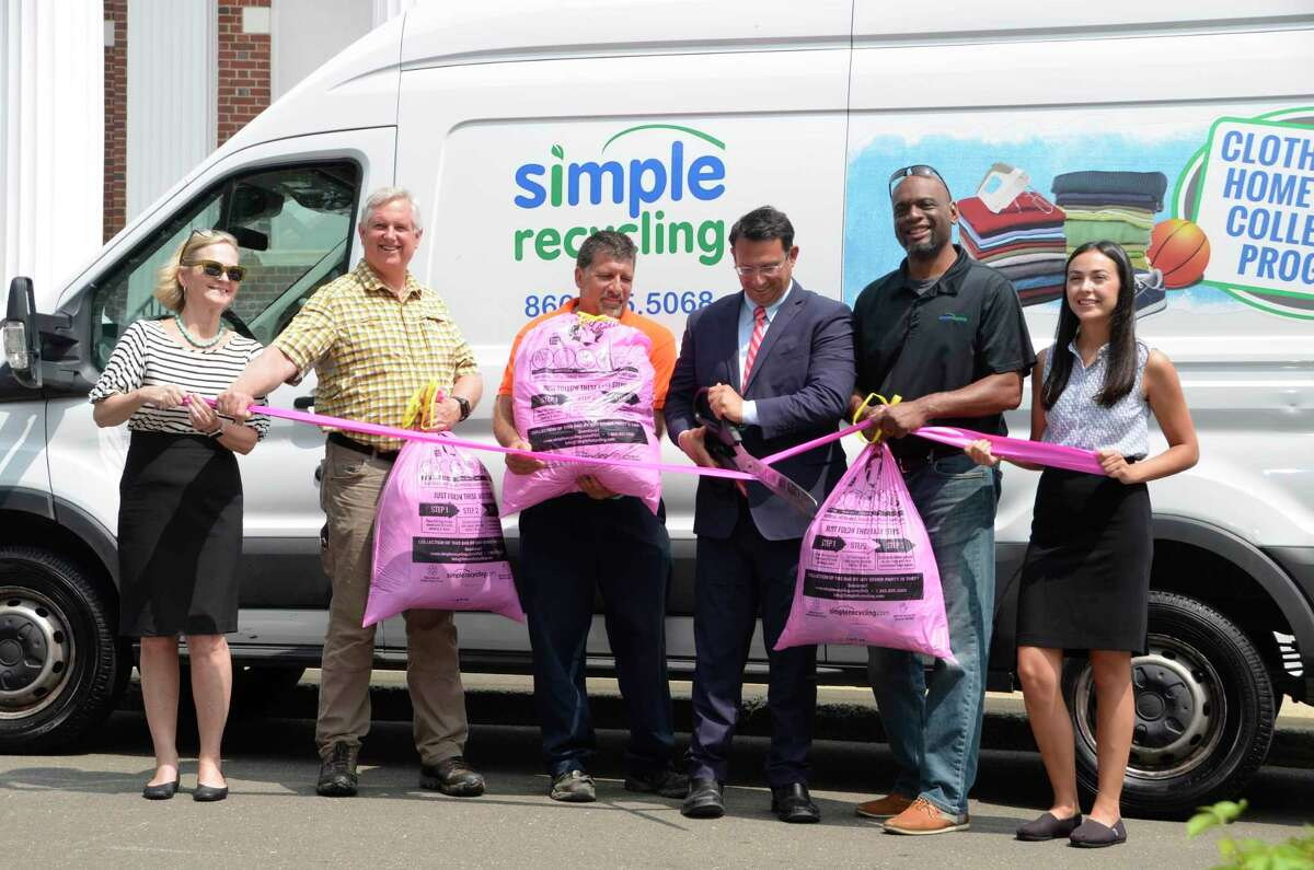 City and company officials gather July 10 in front of Milford City Hall to kick off a textile recycling program, which officially starts July 15, 2019. Pictured from left to right are Kristen Brown with WasteZero, Milford Open Space and Natural Resource Agent Steve Johnson, Milford Sanitation Foreman Bill Plantamura, Mayor Ben Blake, Sonny Wilkins with Simple Recycling, and Savannah Harik with WasteZero.