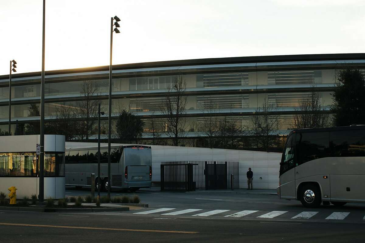Shuttle buses file into the pick up area for Apple employees at Apple Park, one of the world's most valuable buildings.