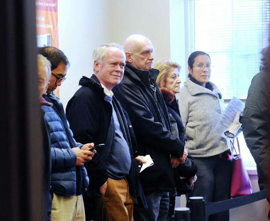 Residents of Greenwich, Conn. line up at town hall to pay their municipal taxes, in December 2017 on the heels of the passage of the Tax Cuts & Jobs Act of 2017. In its first full analysis of the 2017 tax year, the Internal Revenue Service determined that individuals with 2018 income in excess of $1 million constituted the lone bracket to pay higher taxes last year under the revised federal tax code. Photo: Bob Luckey Jr. / Hearst Connecticut Media / Greenwich Time