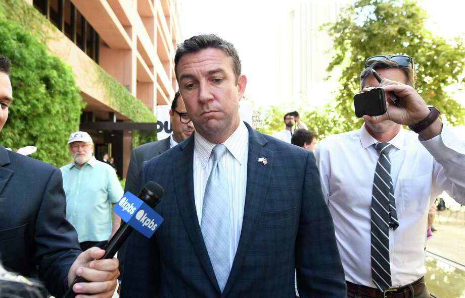 U.S. Rep. Duncan Hunter leaves federal court after a motions hearing Monday  in San Diego. He is charged with looting his own campaign cash to finance vacations, golf and other personal expenses, then trying to cover it up. Photo: Denis Poroy /Associated Press / FR59680 AP