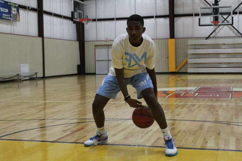 Dylan Miles getting some shots up at The Gym in Atascocita. Miles has spent the summer playing AAU ball with the Basketball Family. Photo: Marcus Gutierrez Staff Photo