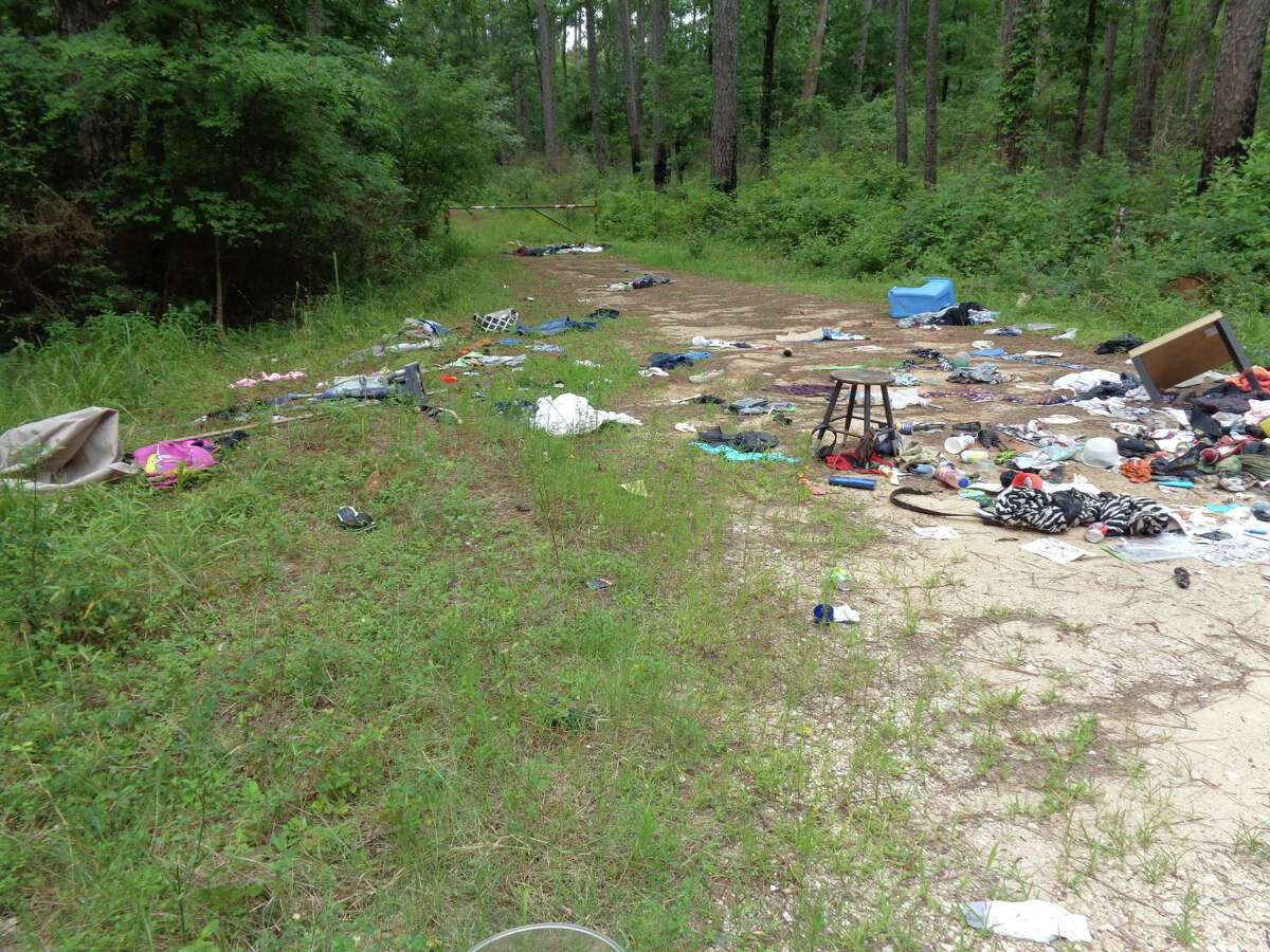 Photo furnished by Montgomery County Precinct 1 Constable's Office shows a dumping site recently found at the Sam Houston National Forest.