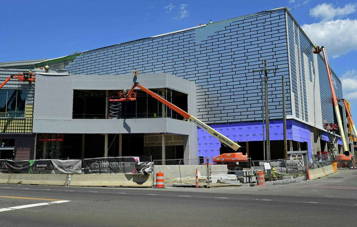 Construction workers with Brookfield Properties continue the build of the SoNo Collection mall Thursday, June 27, 2019, in Norwalk, Conn.