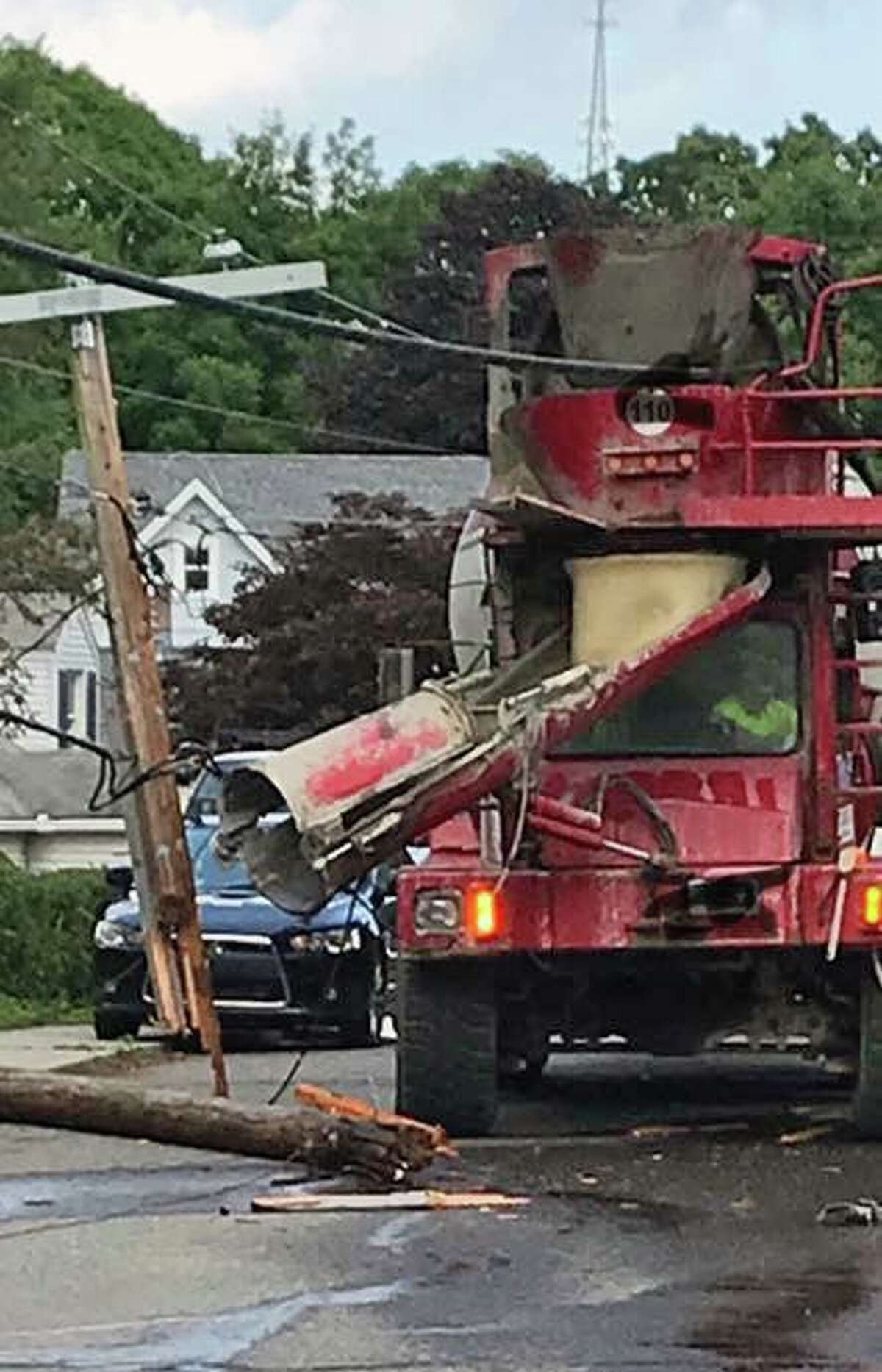 Fire officials from the Citizens' Engine Co. No. 2 said the truck got hung up on high tension wires. Since the high tension wires were entangled with the vehicle, the driver was told to remain in the truck.