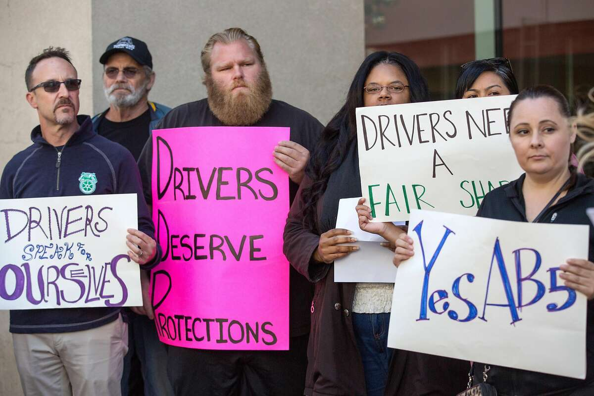 Uber & Lyft drivers and their supporters gather outside of Uber HQ in support of AB5, the California legislation that would make them employees, on June 18, 2019.