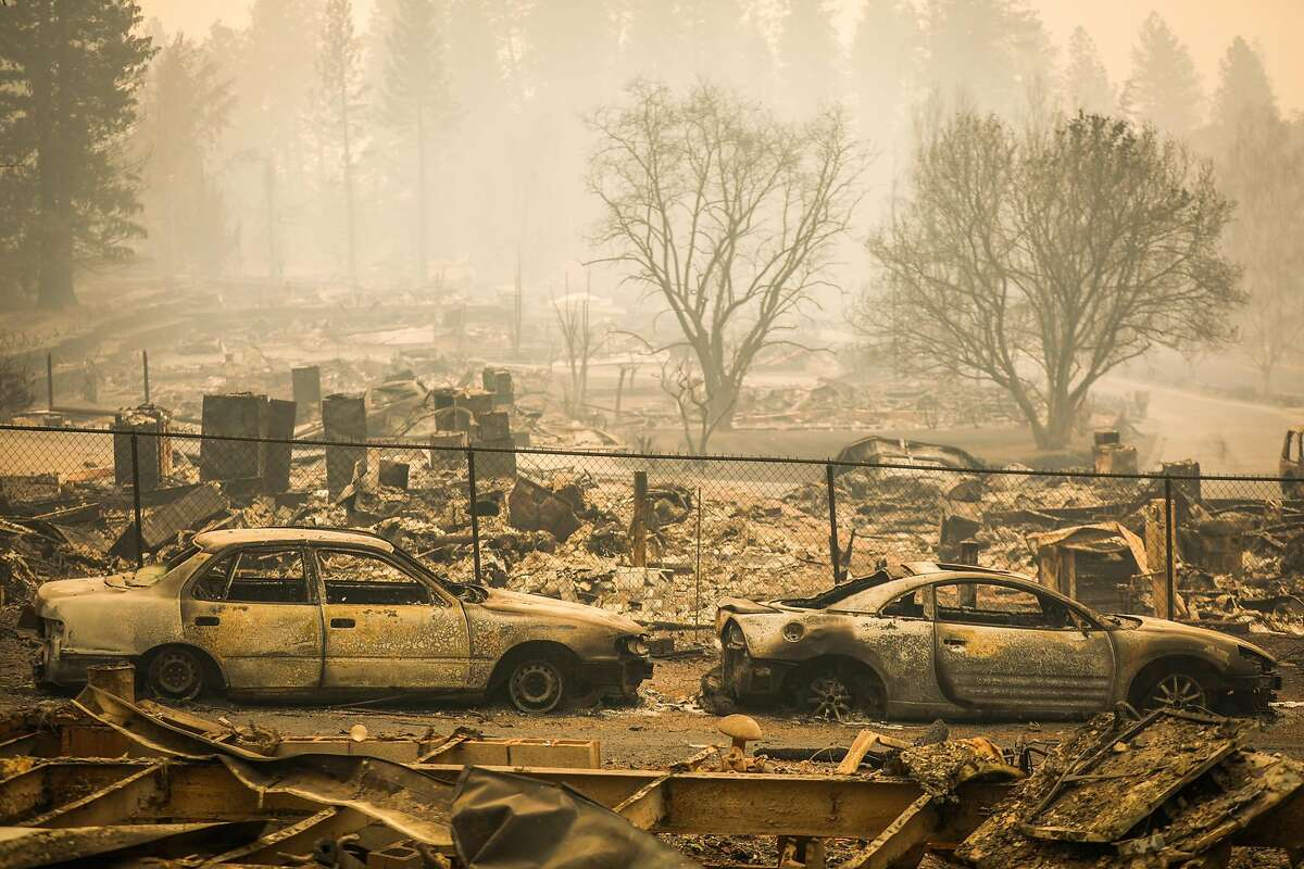 Homes are seen destroyed off of Edgewood Lane following the Camp Fire in Paradise, California, on Wednesday, Nov. 14, 2018.