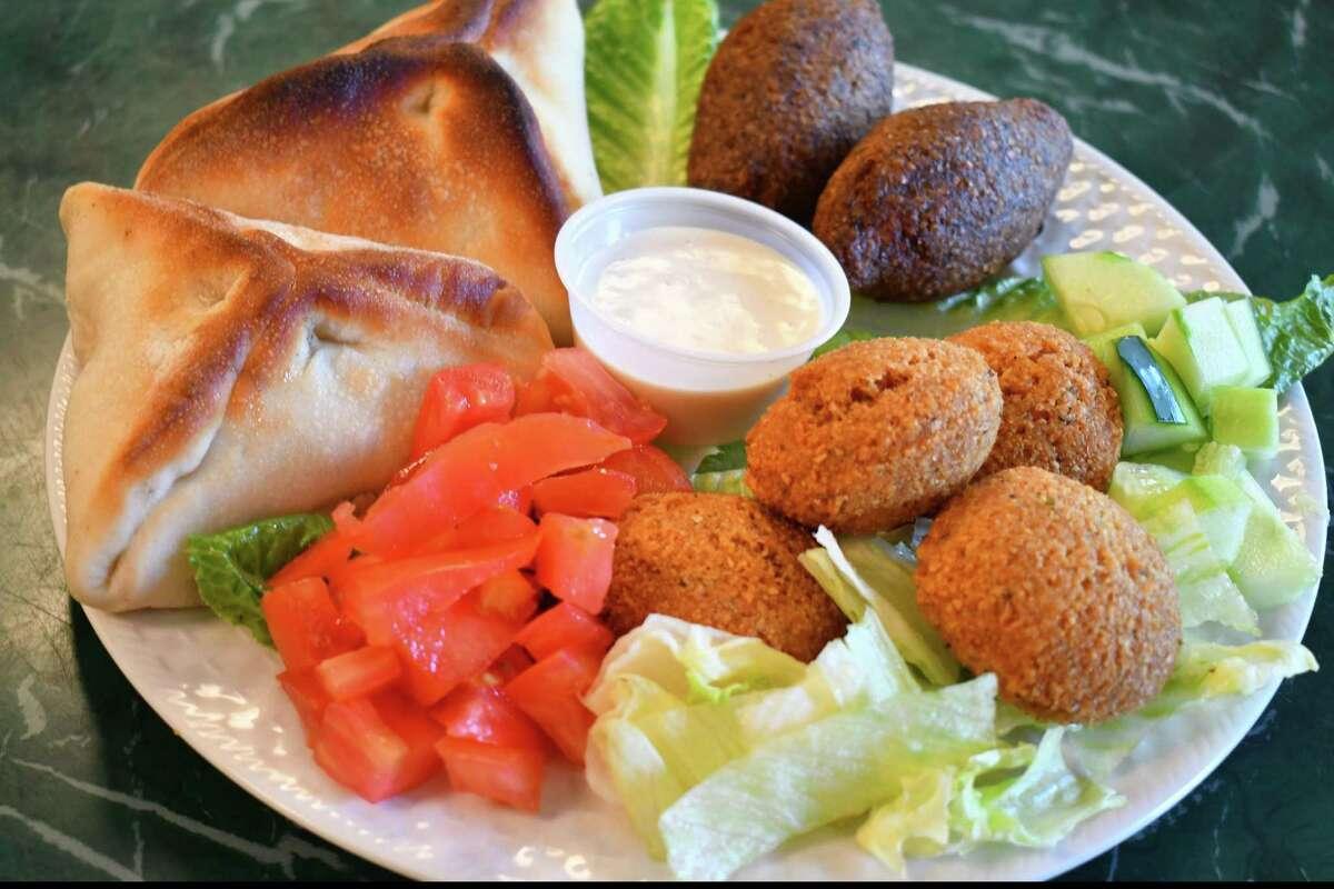 Spinach pie, meat pie, kibbi footballs and falafel at Vivianne's in Danbury.