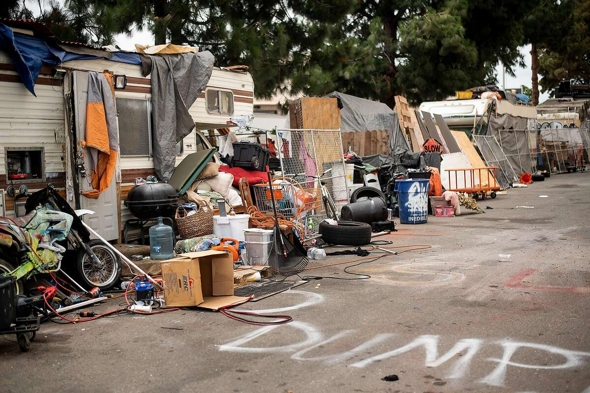 Recreational vehicles line a homeless encampment on 37th Ave. behind Home Depot on Wednesday, July 10, 2019, in Oakland, Calif. The Oakland City Council passed a resolution to ban parking at the location.