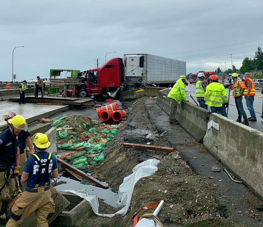 All southbound lanes on Interstate 5 at state Route 16 are being diverted to SR-16 and 38th Street due to a semi-trailer tractor crashing into a barrier Wednesday, July 10, 2019. Photo: Tacoma Fire Department