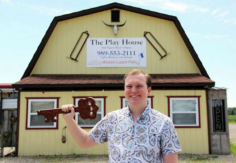 McGregor Crowly, co-owner of The Play House, poses in front of his newly-opened business in Pigeon. Inside the business, visitors will find an escape room -- a team­�?based game where players cooperatively discover clues, solve puzzles, and accomplish tasks in one or more rooms in order to progress and accomplish a specific goal in a limited amount of time. (Andrew Mullin/Huron Daily Tribune)