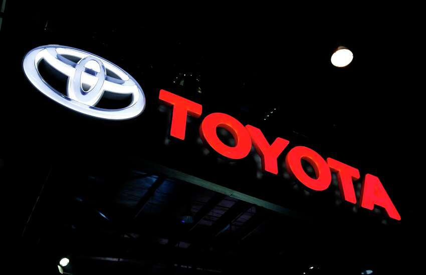 FILE - In this Feb. 7, 2018, file photo the logo of Toyota is displayed at the Auto Expo in Greater Noida, near New Delhi, India. Toyota said Wednesday, July 10, 2019, that it will scrap plans to build the Corolla compact car at a new factory under construction in Alabama. Instead it will build a new unspecified SUV at the plant ita€™s building with Mazda in Huntsville. (AP Photo/Altaf Qadri, File)