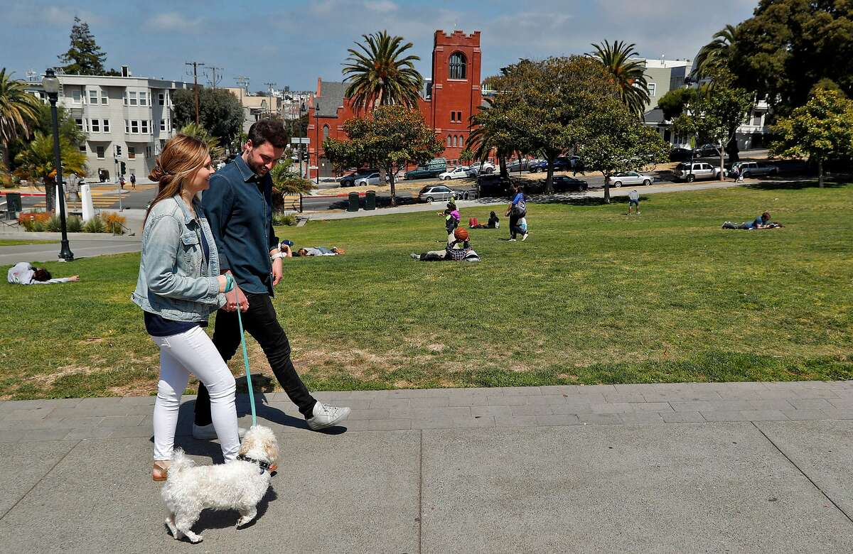 Julia and Jack Altman walk with their rescue dog Teddy in Dolores Park near their home in the Mission District of San Francisco, Calif., on Sunday, July 7, 2019. The Altmans miscarried a baby a little over a year ago and found that reconnecting with nature and being outside to be very therapeutic. Jack felt so moved by the experience that he instituted a miscarriage leave policy at his startup, Lattice.