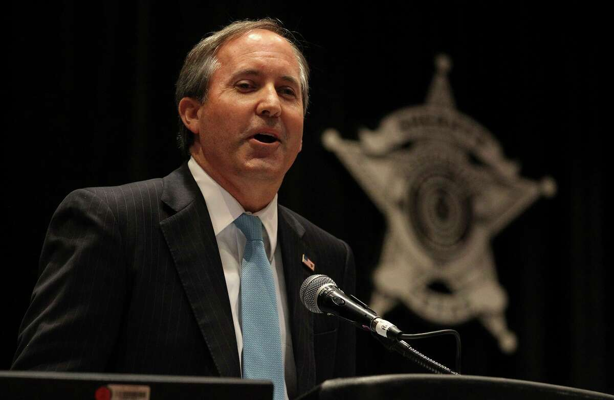 Attorney General Ken Paxton talks to the Sheriffs' Association of Texas in July 2014 at an annual training conference in San Antonio. A state district judge in Austin has dismissed large parts of Paxton's first sanctuary cities lawsuit, which was filed against San Antonio, alleging Police Chief William McManus and others hindered federal immigration enforcement by releasing 12 people suspected of being in the country illegally.