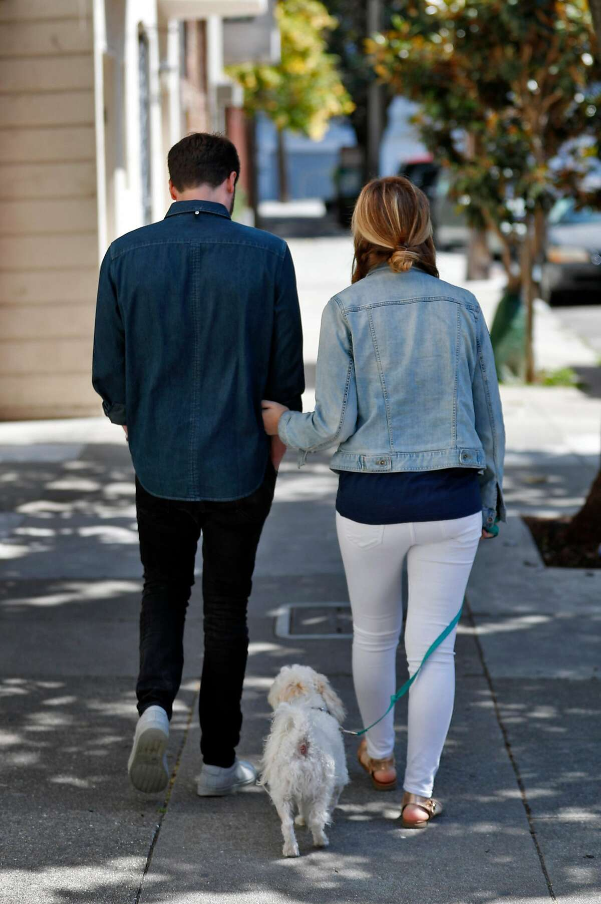 Julia and Jack Altman walk with their rescue dog Teddy near their home in the Mission District of San Francisco, Calif., on Sunday, July 7, 2019. The Altmans miscarried a baby a little over a year ago and found that reconnecting with nature and being outside to be very therapeutic. Jack felt so moved by the experience that he instituted a miscarriage leave policy at his startup, Lattice.