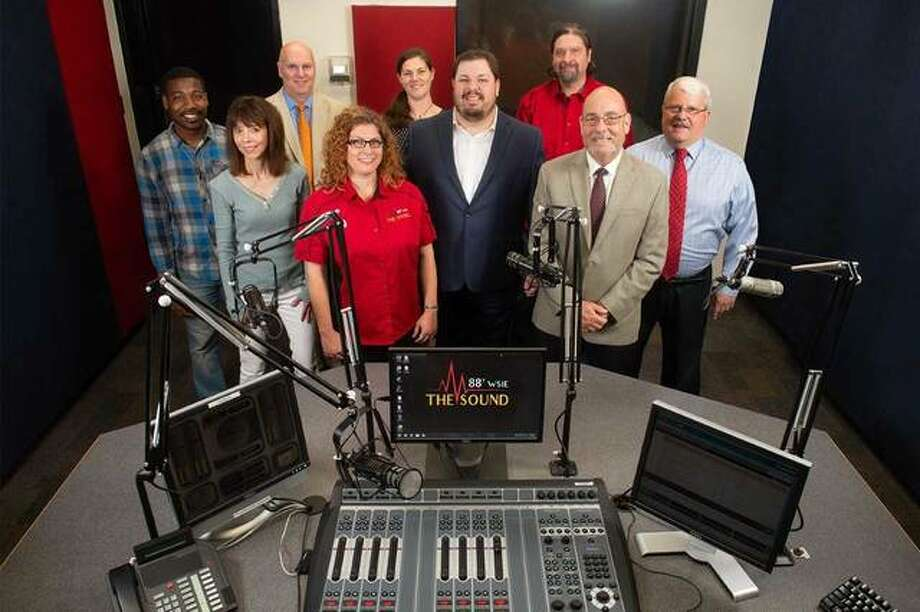 Part of WSIE's staff includes (L-R front row): Ja'Quis (On-Air), Christiann (On-Air), John Grainey (Co-Host Financial Café), Stephanie Lewis (Account Executive), Kayci (On-Air), Jason Church (General Manager), Carlos Bedoya (Chief Engineer), Dean Greg Budzban, PhD (Dean of SIUE College of Arts and Sciences), Larry Lexow (Co-Host Financial Café). Photo: Courtesy Of SIUE