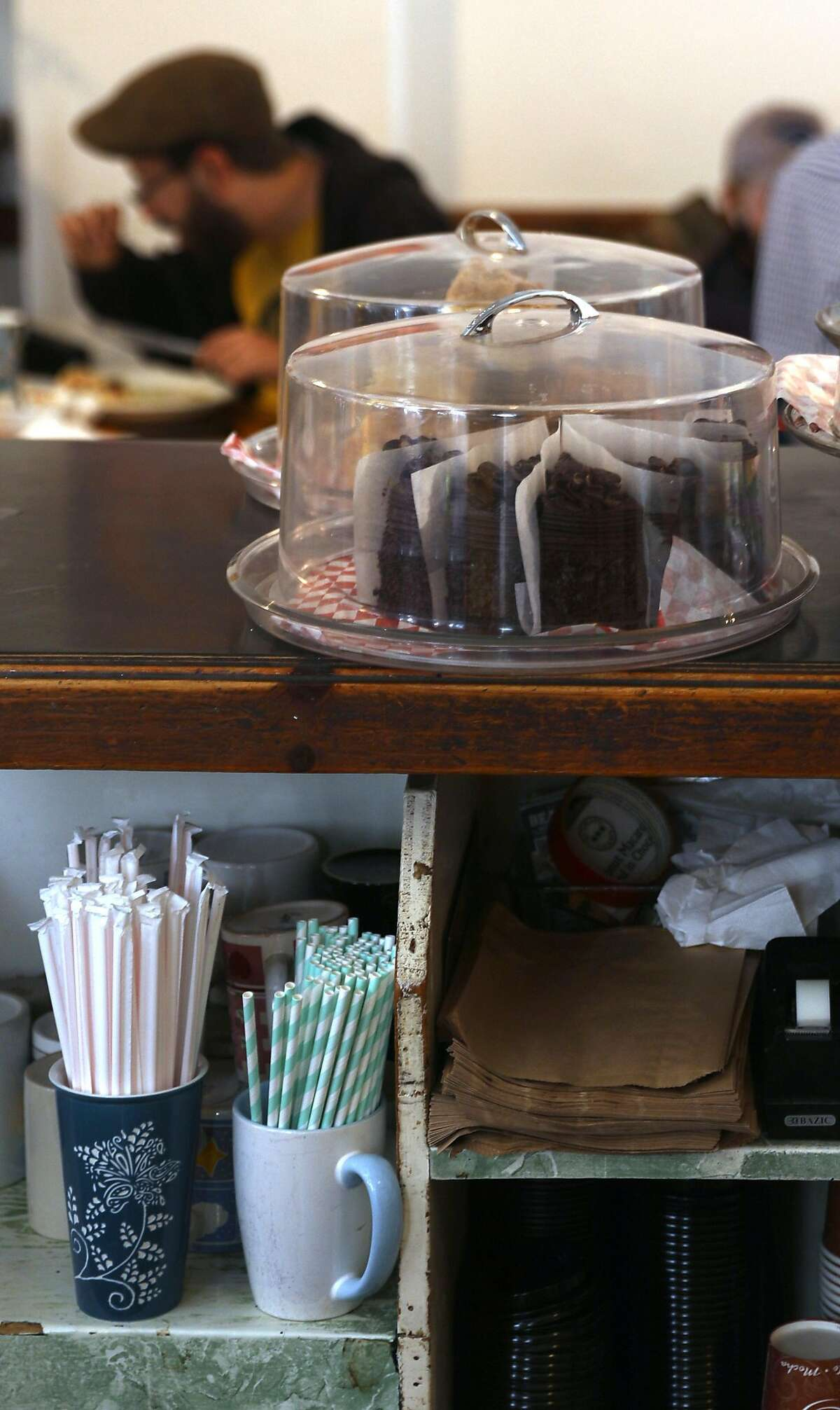 Cafe International has their paper and plastic straws seen stored behind the counter long on Tuesday, July 9, 2019, in San Francisco, Calif. The team from the San Francisco Dept. of the Environment go door to door to let restaurants know about the new law that started July 1, under which restaurants cannot automatically give out plastic utensils, napkins, condiment packages and other disposable items to diners, whether eat-in or take-in. They can give out the items upon request or can offer them in a self-serve area.