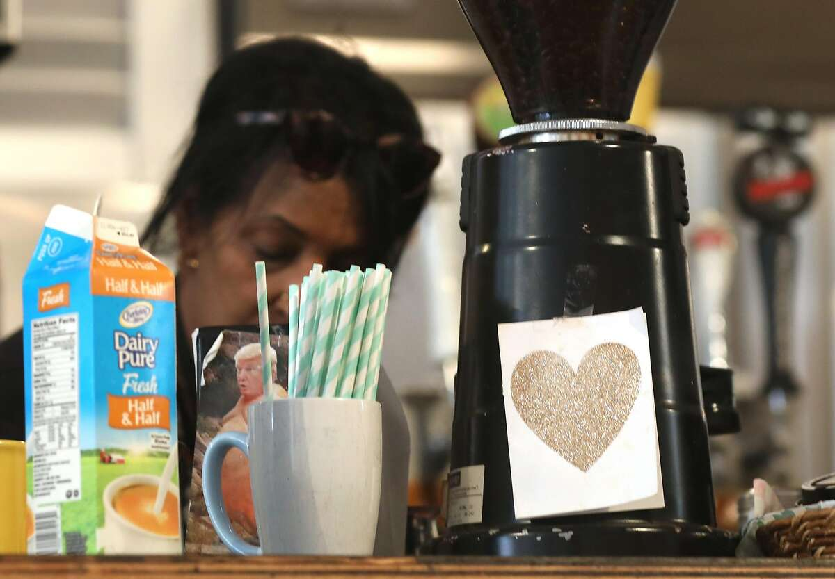 Owner Zahra Saley was just now told to only give out straws when asked and should be placed behind the counter at Cafe International on Tuesday, July 9, 2019 in San Francisco, Calif. A team from the San Francisco Dept. of the Environment go door to door to let restaurants know about the new law that started July 1, under which restaurants cannot automatically give out plastic utensils, napkins, condiment packages and other disposable items to diners, whether eat-in or take-in. They can give out the items upon request or can offer them in a self-serve area.